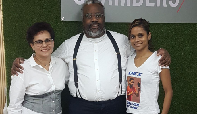 IT'S OVER!: Jeromaine St Louis, left, and Rheann Chung, right, celebrate with their lawyer Matthew Gayle at New City Chambers in Port of Spain, yesterday, following completion of the Dexter St Louis/Rheann Chung vs Trinidad and Tobago Table Tennis Association (TTTTA) case, at the Hall of Justice. The parties agreed on a settlement.   --Photo: KWAME LAURENCE