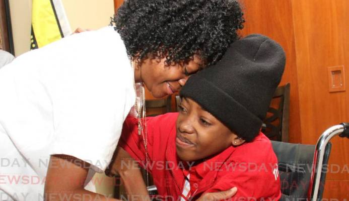 Special Olympian Shanice Baptiste is welcomed by her mother Ava Baptiste, as she arrived at the VIP Lounge of the Piarco International Airport from Abu Dhabi in April last year. Shanice died on Friday after ailing with a lung disorder. FILE PHOTO - FILE PHOTO